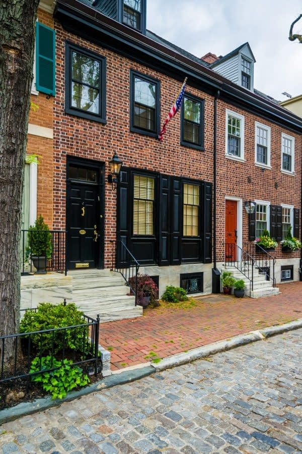 Historic brick row houses on a cobblestone street in Society Hill, Philadelphia, Pennsylvania.